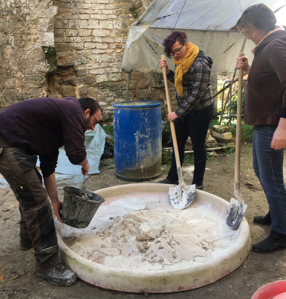 Group practicing mixing lime mortar